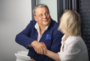 Mature businesspeople having a good deal. Man and woman shaking hands to make a business agreement